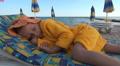 Child, Little Girl Sleeping on Beach, Sleepy Kid on Seashore, Children Lifestyle Footage