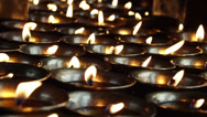 Stock Video Footage of Candles Burning in Buddhist Temple