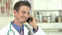 Doctor giving good news over the phone Stock Footage
