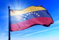 venezuela flag waving on the wind - stock illustration