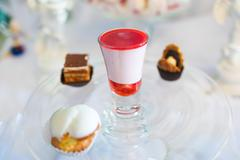 Liquor and candies on a plate Stock Photos