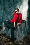 Beautiful woman against autumn decoration. Fashion Stock Photos