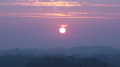 Sun rising through early morning haze.- Time Lapsed Stock Footage