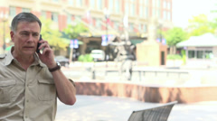Man walks by in slow motion on cell phone Stock Footage