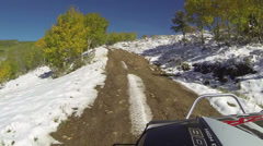 Driving 4x4 muddy muddy snow road high mountain HD 0074 Stock Footage