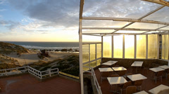 Beach bar sunset timelapse Stock Footage