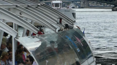 Tourist enjoying scenery on cruise boat at River Seine, Paris France. - stock footage