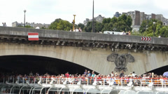 Cruise boat passing under Pont d'Iéna, River Seine, Paris (PARISboatTOUR3D - stock footage