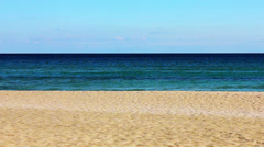 An empty beach at noon - stock footage