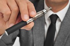 Vaping with an electronic cigarette Stock Photos
