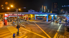Timelapse of Traffic and Lightrails At Junction Stock Footage