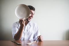 young stylish man with white shirt and dish in his face - stock photo