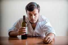 drunk young stylish man with white shirt - stock photo
