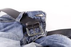 blue jeans and a black leather belt - stock photo