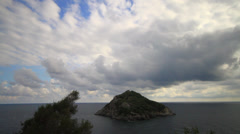 Threatening sky and island. T Lapse Stock Footage