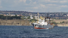 Fishing boat out to fish Stock Footage