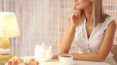 Charming young woman sitting at table at cafe looking at camera and smiling Stock Footage