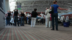 Larnaca international airport hall with passengers boarding on aircraft Stock Footage