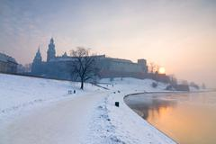 historic royal wawel castle in cracow, poland, with frozen vistula river in w - stock photo