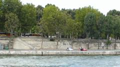 River bank and walkpath of Seine, Paris, France (PARIS SEINE RIVER BANK--1B) Stock Footage
