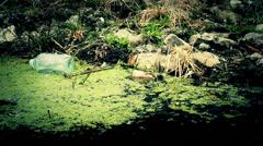 Trash, plastic bottles  in river Stock Footage