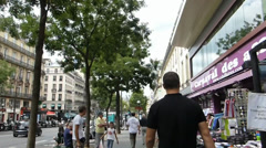 OUTDOOR STALLS IN PARIS ,WITH SOUND.(ROADSIDE STALL ALONG WALKWAY IN PARIS,) Stock Footage