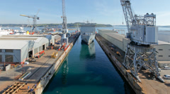 Naval ship arriving at Falmouth Docks dry dock, Cornwall, England - stock footage