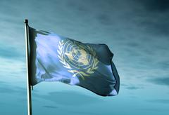 un flag waving in the evening - stock illustration