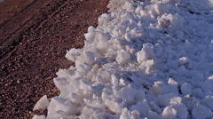 Sunset Timelapse on Pile of Snow Stock Footage