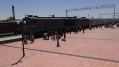 Train arrives at station in Uzbekistan, Central Asia, former Soviet Union Stock Footage