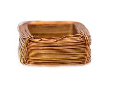 A coil of copper wire on a white background Stock Photos