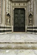 particular of the door of the cathedral   of  florence - stock photo
