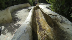 Water flowing down through gutter which doubles as hand rail Stock Footage