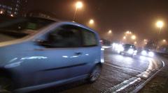 Night traffic in fog Stock Footage