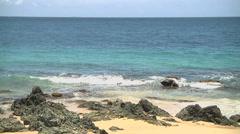 Waves splashing rocks mov file Stock Footage