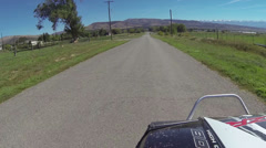Riding 4x4 ATV RZR rural town streets HD 4074 Stock Footage