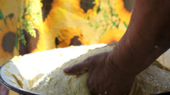 Woman cook  hands fret the dough in bowl in traditional way outdoor - stock footage