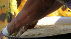 Woman cook  hands fret the dough in bowl in traditional way,  to make the bread - stock footage