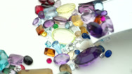 Stock Video Footage of mixed gemstones with shovel