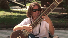 CHILE - CIRCA 2007: Musician playing Indian Sitar in Valparaiso, Chile Stock Footage