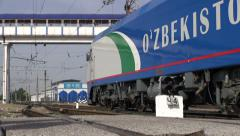 Modern train leaves Tashkent station, Uzbekistan Stock Footage