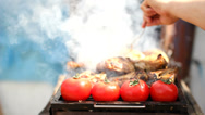 Stock Video Footage of Hand with a fork prepare the meal, steak and tomatoes on grill, steam lift up