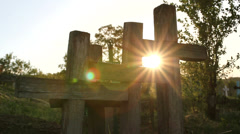 Stock Video Footage of Shiny sun lighting in a graveyard between christian cross