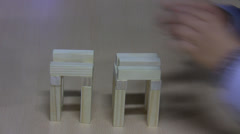 Two kids building tower from toy blocks - stock footage
