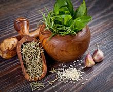 macro composition of italian cooking ingredients, garlic, rosemary, basil lea - stock photo