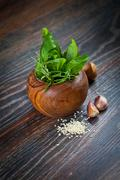 macro composition of italian cooking ingredients, garlic, rosemary, basil lea - stock photo
