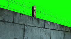 Barbed wire and concrete wall greenscreen Stock Footage