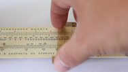Stock Video Footage of calculations on a slide rule.