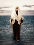 jesus walks on water - stock photo