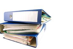 stack of folders. pile with old documents and bills. isolated on white backgr - stock photo